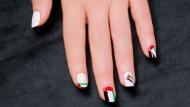 دعي علم الإمارات يزين أظافرك احتفالاً باليوم الوطني